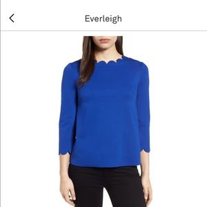 Blue top scalloped neck line and sleeves.